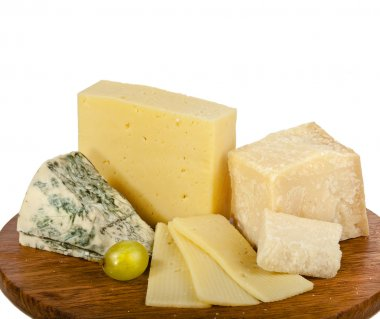Various cheeses on the wooden board isolated on white