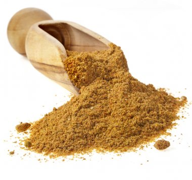 Scoop with curry powder isolated on white