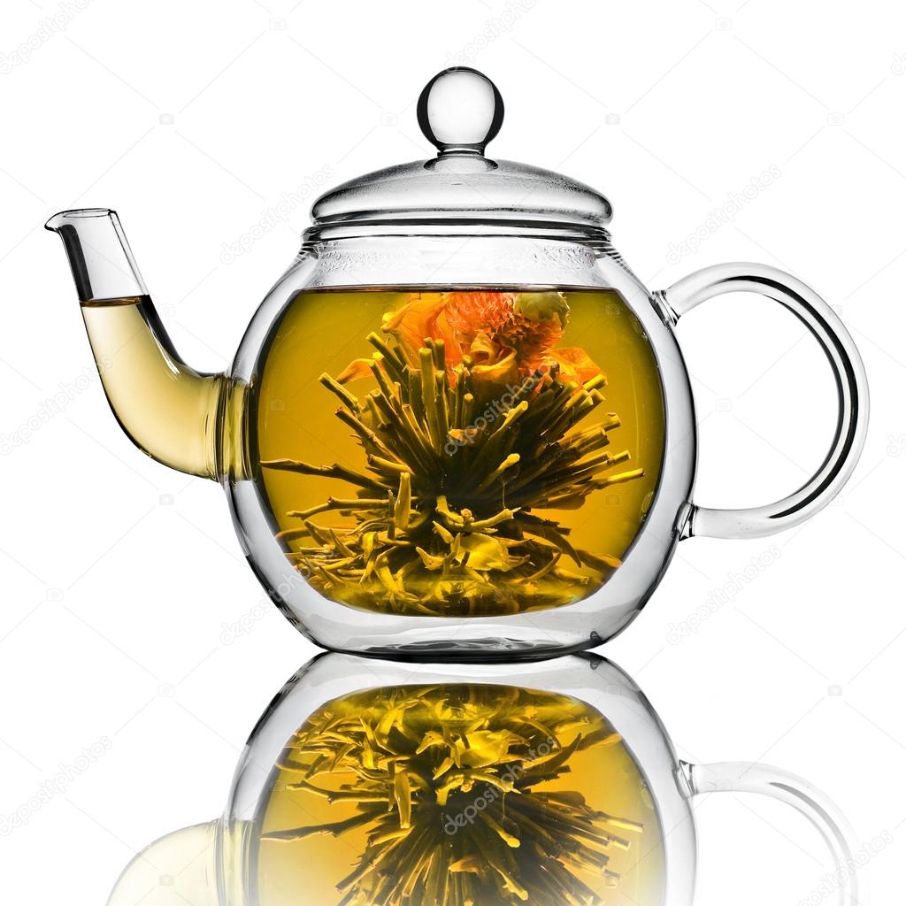 Chinese flower tea - A Glass Tea Pot With Flower Chinese Tea Isolated On A White Background Stock Image