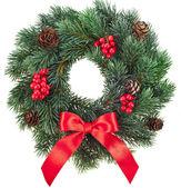 Fényképek Karácsonyi dekoráció koszorú piros Holly bogyók a elszigetelt fehér háttér