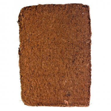 A compressed bale of ground coconut shell fibers (coir), surface background