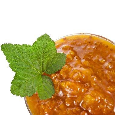 Cloudberry jam close up macro shot isolated on white background