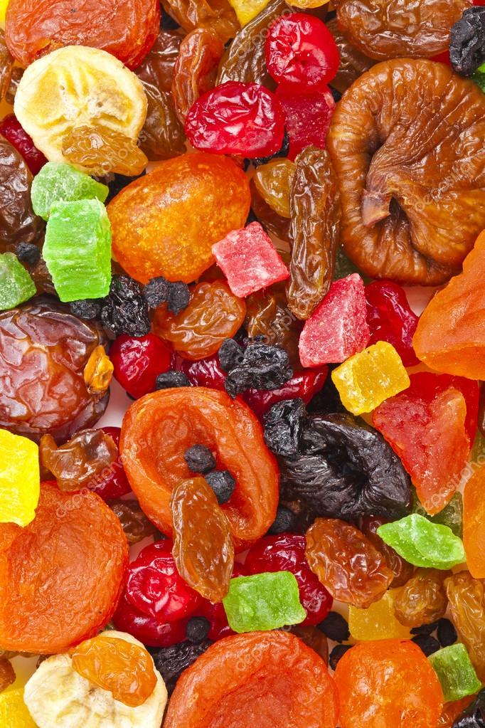 Tasty sweet mix dried colorful fruits top view surface background