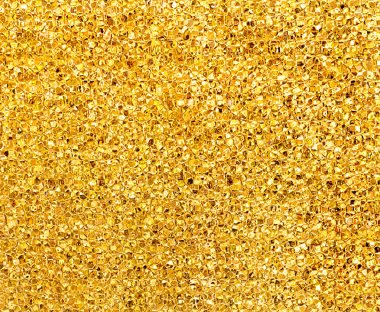 Golden glitter background texture closeup