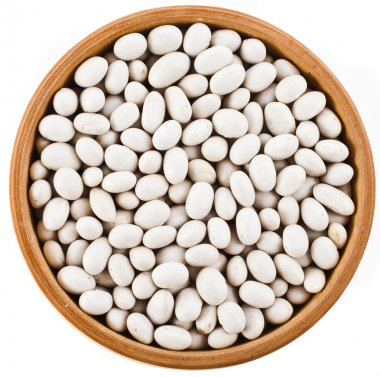 White peas beans in wooden bowl dish top view close up