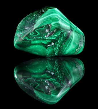 Malachite mineral stone close up with reflection