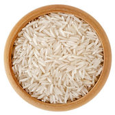Photo Polished long rice basmati in a wooden bowl isolated on white background