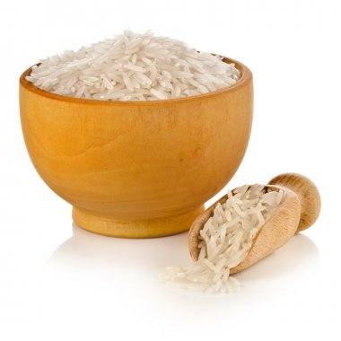 Long grain rice in a wooden bowl isolated on white background