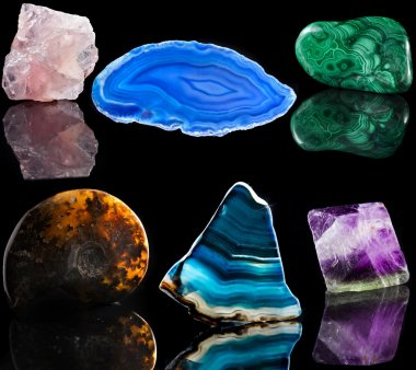 Collection set of mineral stone close up with reflection on black surface background
