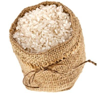 Basmati rice in small burlap sack isolated on white background
