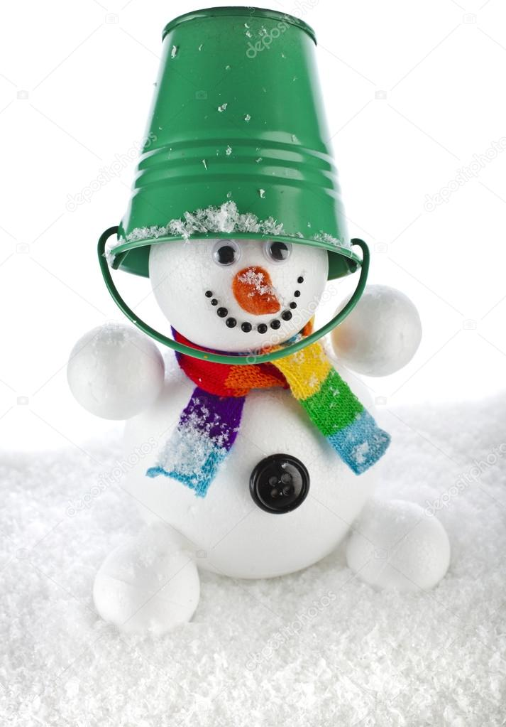 aee4c5667d8a9c Funny snowman with green color bucket on his head isolated on white  background — Stock Photo