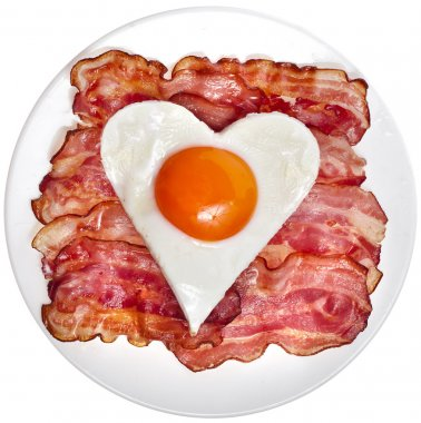 Fried bacon with egg in shape of heart