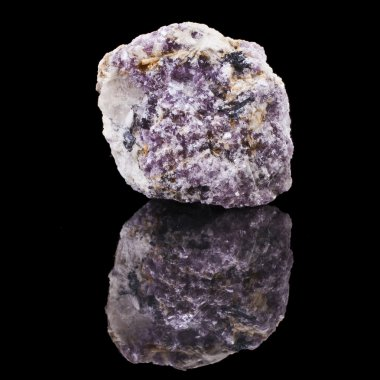 Lepidolite with reflection on black surface background