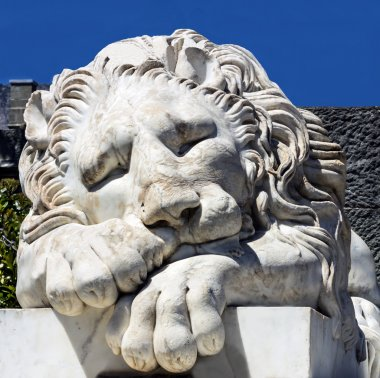 Marble sculpture of sleeping lion