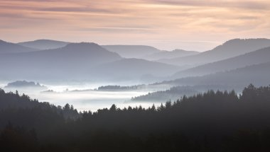 Mist on hills in morning landscape