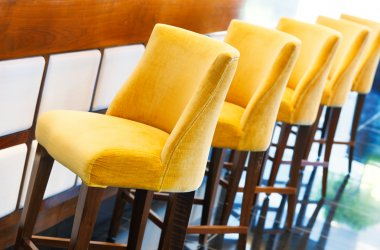 The warm yellow bar stools