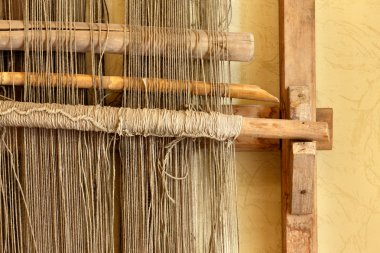 An ancient hand loom used to weave blankets