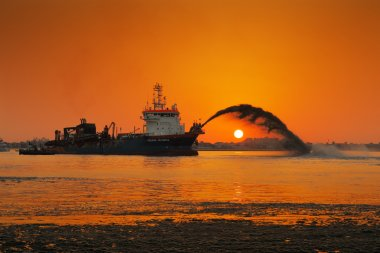 A dredging ship in action at Palm Jumeirah, Dubai, UAE