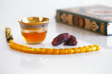 Masbaha, Quran, Arabic tea and dried dates are symbols of Ramadan