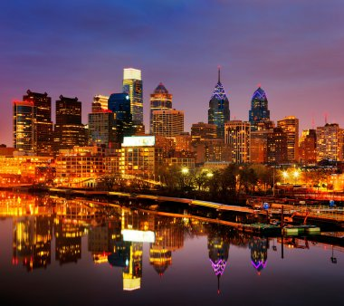 A dusk image of Philadelphia, is reflected in the Scullykill River, as seen from the South Bridge