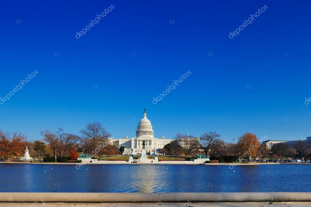 The United States Capitol behind the Capitol Reflecting Pool in Washington DC, USA