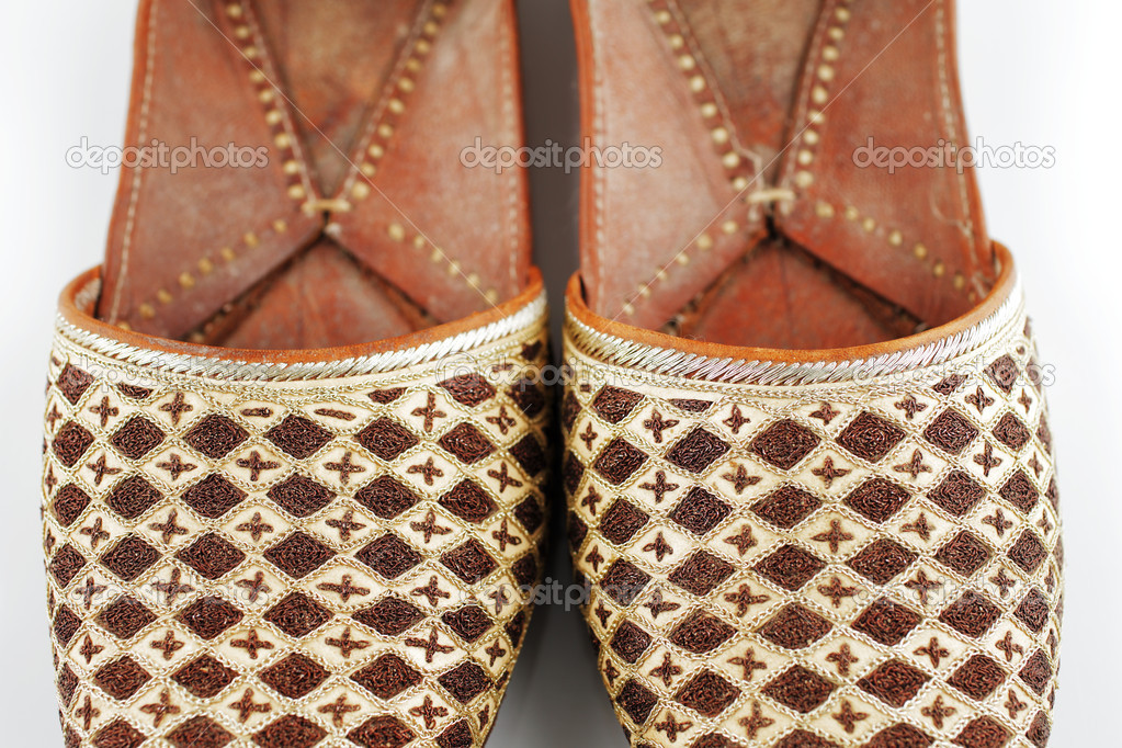 66435799e2a Traditional Arabic slippers shot against a white background — Photo by  Sophie James