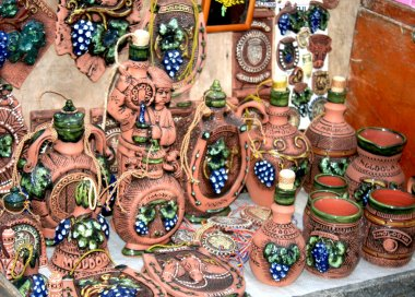 Decorative clay plates cups and jugs decorated with blue grapes Moldova