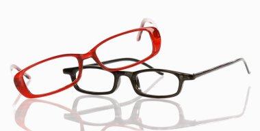 two pair of eye glasses