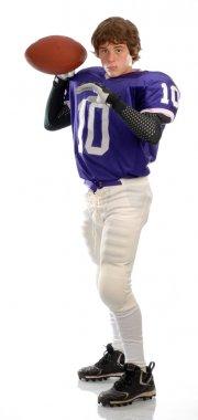teenage boy wearing football uniform