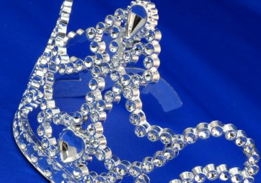 tiara or crown details on blue background