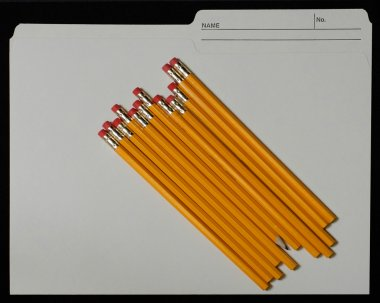 manilla file folder with pencils on top