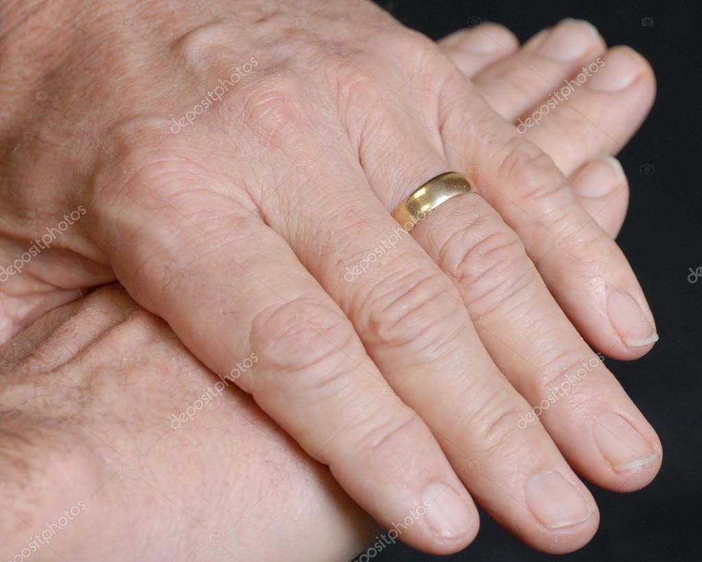 hand details of senior married man on black background — Stock Photo ...
