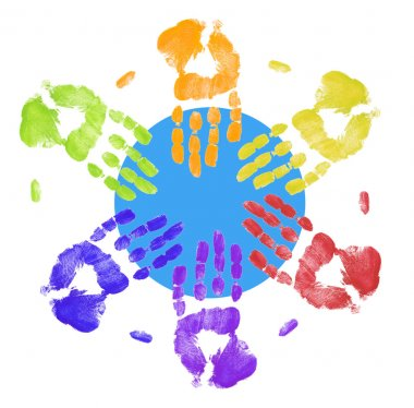 multi colored hands touching globe together