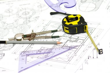Tools and papers with sketches on the table. technical drawings