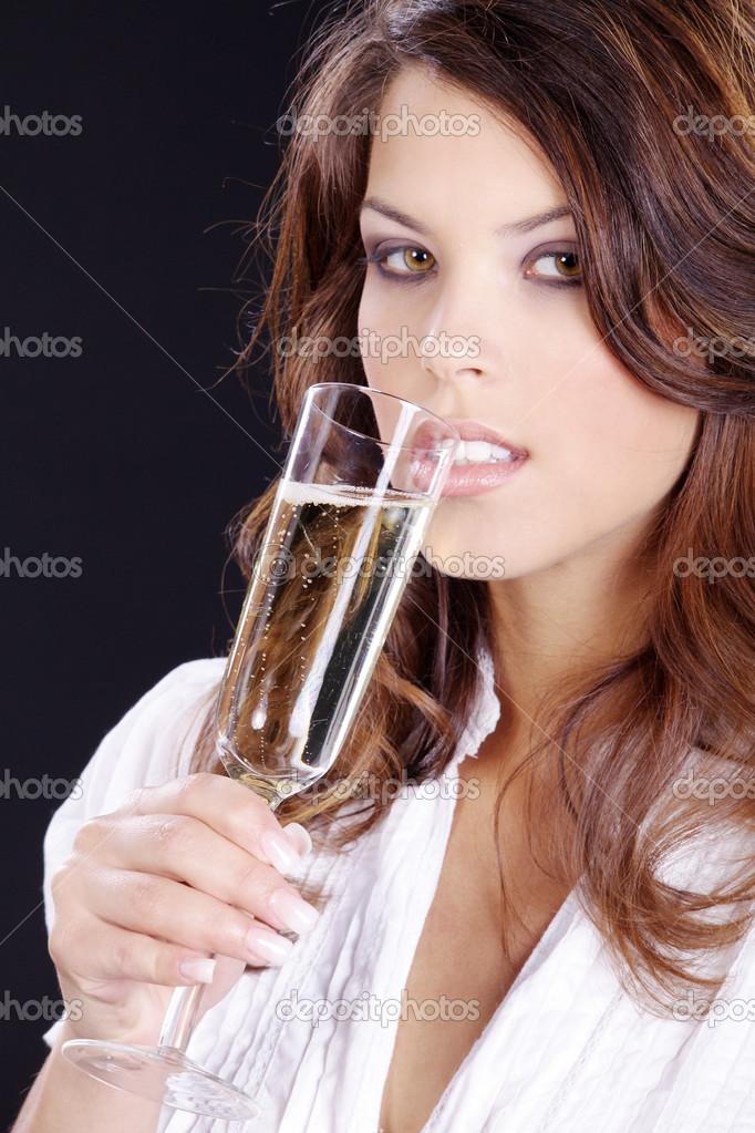 fille avec une coupe de champagne photographie nick freund 28517883. Black Bedroom Furniture Sets. Home Design Ideas