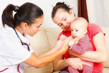 Pediatrician checking a baby