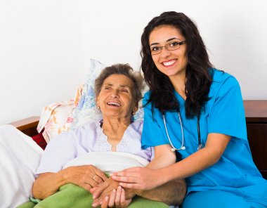 Caring nurse with patient