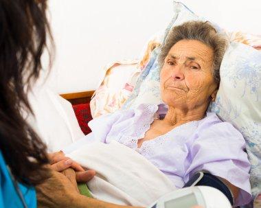 Nurse caring for senior patient