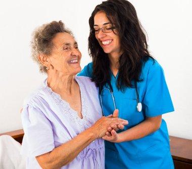 Nurses caring about elderly patient