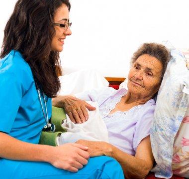 Kind nurse with elderly lady
