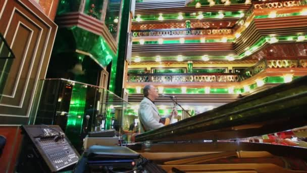 Musician in the lobby of Costa Concordia cruise ship