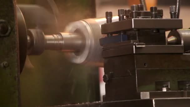Heavy industry - processing steel on a lathe in factory