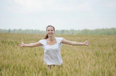 Happy woman in a meadow