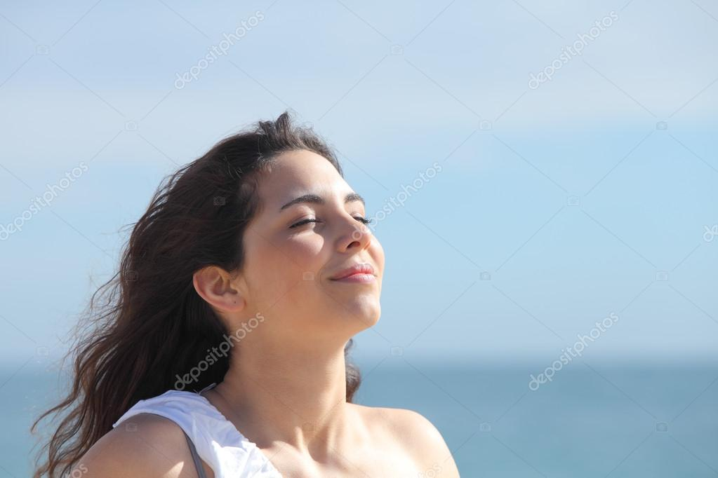 Beautiful girl breathing on the beach