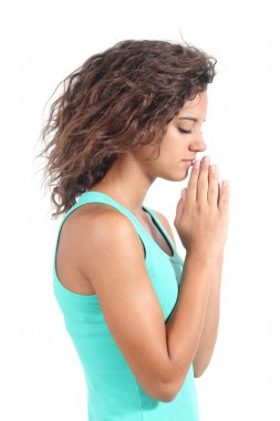 Pretty teenager girl praying