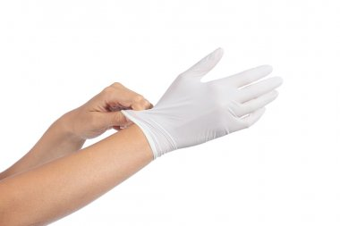Woman hands putting on a latex gloves