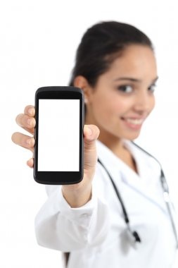 Beautiful female doctor showing a smart phone screen isolated