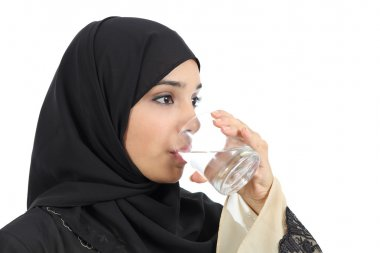 Arab woman drinking water from a glass
