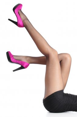 Beautiful woman legs with fuchsia high heels and black tights pointing up isolated on a white background stock vector