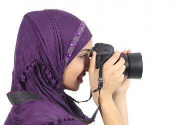 Arab woman photographer holding a dslr camera